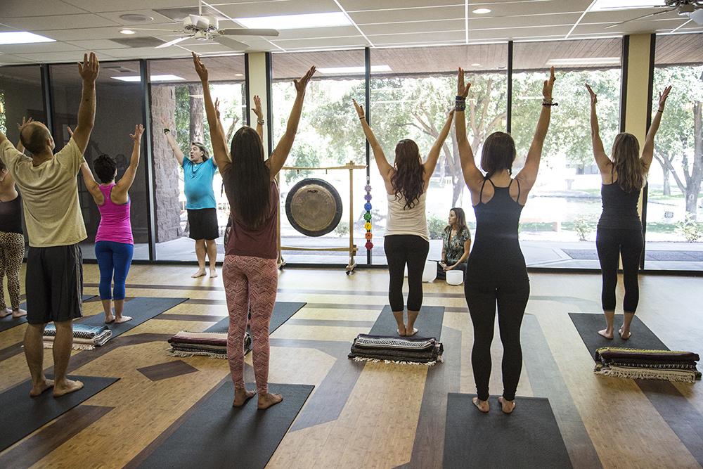 Massage Therapists Practicing Yoga